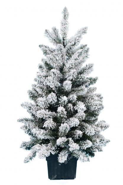 Maly biely vianočný stromček v umelom kvetináči.