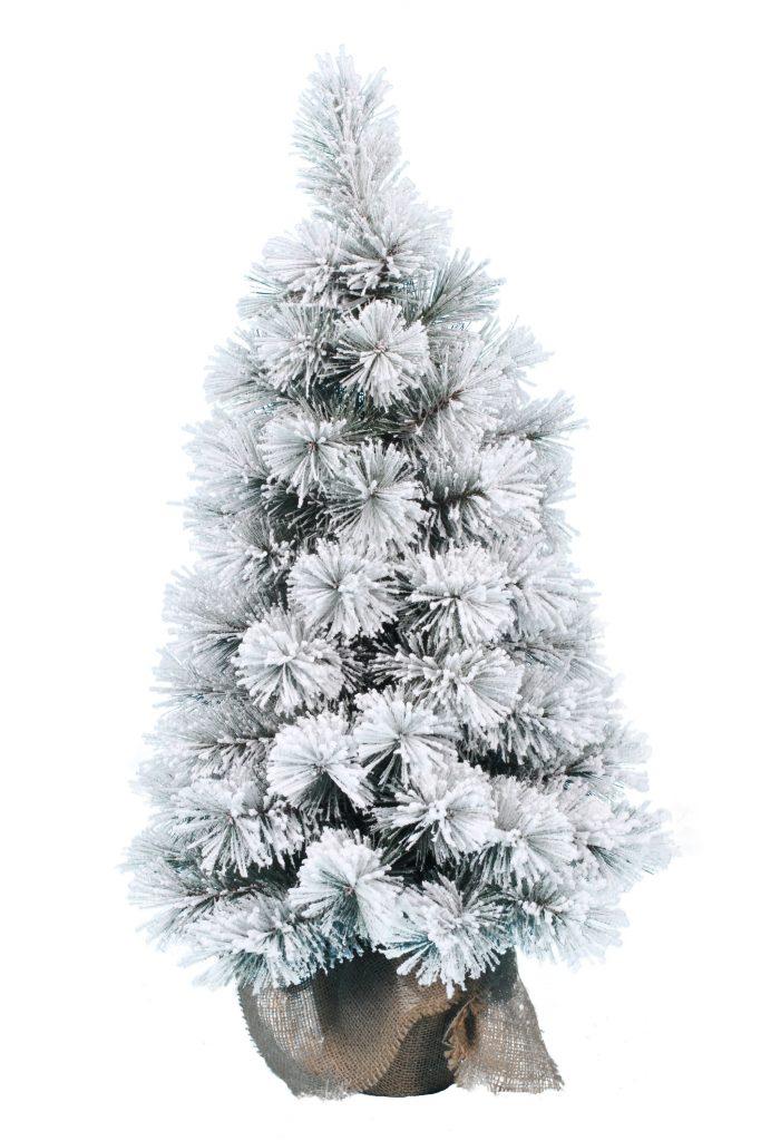 Na obrázku je malý , huňatý stromček cely pokrytý umelým snehom. Stromček stoji na umelom podstavci zabalenom vo vrecovine.