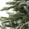 Detailná fotka vetvičiek umelého vianočného stromčeka 3D Smrek zasnežený . Vetvičky sú pokryté bielym 3D snehom.