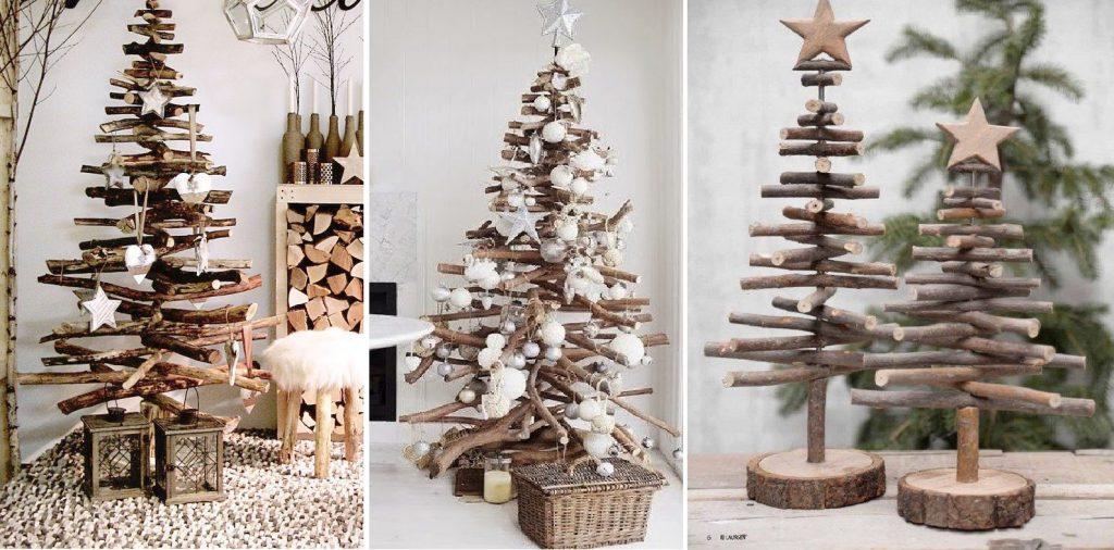 Na obrázku sú 3 rôzné tipy drevených vianočných stromčekov vyrobených z konárov stromov a prútia. Stromčeky sú ozdobené bielými vianočnými ozdobami .