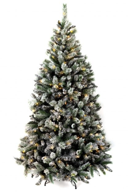 Zasnežený vianočný stromček Borovica Biela s LED osvetlením teplej bielej farby.