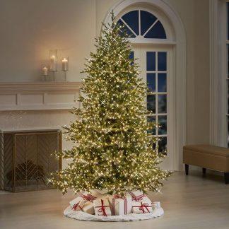Umelý vianočný stromček so svetielkami a darčekmi